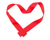 Red ribbon in heart shape — Stock Photo