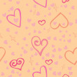 Seamless texture of pink hearts — Stock Vector