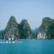 Stock Photo: Fish farms and karst limestone islands, HLong Bay, Vietnam