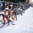 Stock Photo: Bicycles in New York under heavy snowfall.