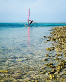 Winsurfer near shore at Glover's Reef, Belize. — Stock Photo