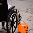 Wheelchair and jack o lantern bucket, Halloween. — Stock Photo
