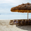 Sunchairs on beach in HLong City. — Stock Photo #37561867
