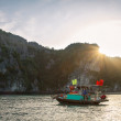Small, traditional fishing boat in HLong Bay, with sunburst. — Stock Photo #37563927