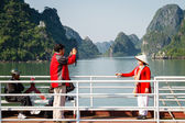 Tourists take photos during a cruise of the UNESCO World Heritage site. — Stock Photo