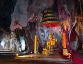 Buddhist temple deep in an underground cave. — Stock Photo