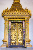 Ornate golden doorway at Buddhist temple, Laos. — Stock Photo