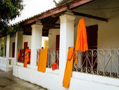 Buddhist monks' robes hung on laundry lines. — Stock Photo