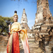 Woman performing typical thai dance with thai style temple background — Стоковая фотография