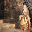Woman wearing typical thai dress with thai style temple background — Photo