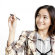 Businesswoman with a pen in her hand — Stock Photo