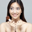 Portrait of the beautiful woman with make-up brushes near attractive face. — Stock Photo