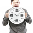 Time concept,Businessman holding big clock and give the expression on his face — Stock Photo #27908881