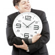 Preservation of times,close up of young businessman with analog clock isolated on white background — Stock Photo