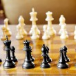 Set of chess figures on the playing board — Stock Photo #28019165