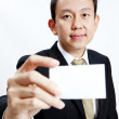Portrait business man holding blank note card — Stock Photo