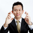 Superstitious - entrepreneur with crossed fingers over white background — Foto Stock