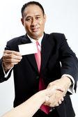 Zakenman in pak geven een hand voor handdruk te verzegelen de deal — Stockfoto