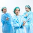 Group of smiling female medical doctor and nurse with stethoscope and clipboard — Stock Photo