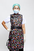 Smiling young female medical doctor with mask — Stock Photo