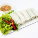 Fresh Handmade Vegetable Spring Rolls On White Surface — Stock Photo #28249383