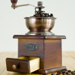 Vintage coffee grinder with coffee beans — Stock Photo #28252247