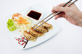Fried Pork and Shrimp Dumplings on a dish with Soy Sauce and chopsticks — Stock Photo