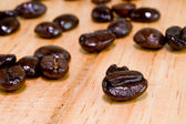 Coffee beans on a wooden table — Stock Photo