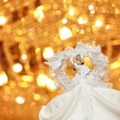 Wedding couple doll on gold background — Stock Photo