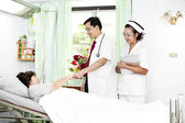 Doctor and nurse talking with a patient — Stock Photo