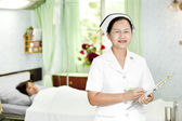 Friendly doctor with patient — Stock Photo