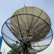 Parabolic satellite dish space technology receiver over blue sky — Stok fotoğraf
