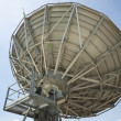 Parabolic satellite dish space technology receiver over blue sky — Stock Photo