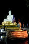 Buddha sculpture at night — Stock Photo