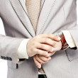 Businessman checking the time on his watch — Stock Photo