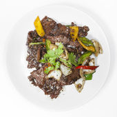 Stir-fry beef with vegetables and spices — Stock Photo
