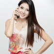 A shot of an asian woman using the phone — Stock Photo