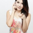 A shot of an asian woman using the phone — Stock Photo #28671309