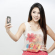 A shot of an asian woman using the phone — Stock Photo #28671741