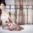 Gorgeous asian woman in thai dress lying on bed — Stock Photo #28696903