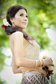 Gorgeous asian woman in thai dress — Stock Photo