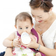 Stock Photo: Mother feeding baby daughter