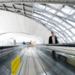People rushing on escalator in motion blur — Stock Photo #29060653