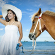 Asian woman and a horse — Foto Stock