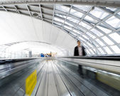 People rushing on the escalator in motion blur — Stock Photo