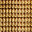 Many small Buddha statue on the wall at chinese temple, Thailand — Stock Photo #31218795