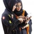 Muslim asian female students with tablet computer — Stock Photo #33094341