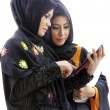 Muslim asian female students with tablet computer — ストック写真