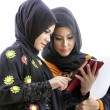 Muslim asian female students with tablet computer — Stock Photo #33094429