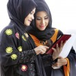 Muslim asian female students with tablet computer — Stock Photo #33094479